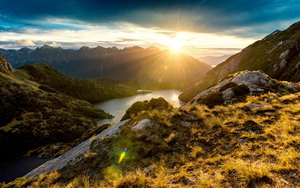 Фото обои горы, камни, скалы, Новая Зеландия, залив, лучи солнца, фьорды