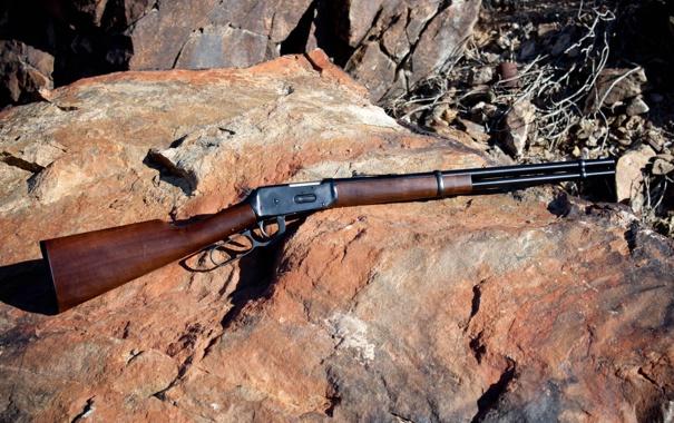 Фото обои оружие, камень, ружьё, Винчестер