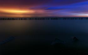 Обои закат, пейзаж, сваи, небо, океан, ночь