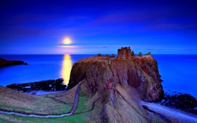Обои замок, закат, скалы, небо, дорога., море
