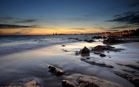 Картинка море, пляж, небо, закат, город, огни, камни