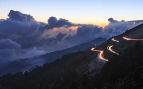 Обои дорога, небо, облака, огни, холмы, вечер, серпантин