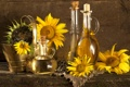 Картинка подсолнухи, стол, масло, семечки, графин, ведёрко, бутыли