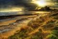Картинка море, небо, трава, закат, тучи, камни, замок
