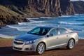 Картинка волны, скалы, берег, Chevrolet, Шевроле, седан, передок
