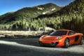 Картинка лес, горы, оранжевый, McLaren, ели, сосны, MP4-12C