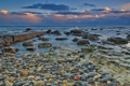 Картинка море, небо, облака, закат, камни, пирс, камешки