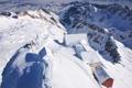 Картинка снег, горы, следы, дома, сугробы, вид сверху, заснежено