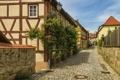 Картинка цветы, улица, дома, Германия, переулок, мостовая, фанари