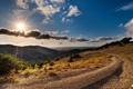 Картинка дорога, солнце, облака, горы