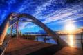 Картинка небо, солнце, облака, свет, закат, мост, дома