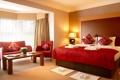 Картинка цветы, комната, кровать, кресло, подушки, окно, светильник