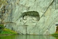 Картинка трава, вода, скала, озеро, лев, Switzerland, швейцария